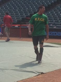 Grant Balfour in cowboy boots before the game. (John Shea/The Chronicle)