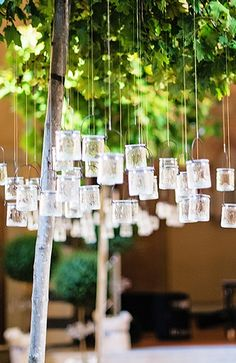 Tea lights hang from birch trees in the Four Seasons Hotel Florence reception space.