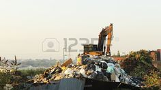 Picture of Junk yard digger on a mound of refuse with two magpies sitting a top the arm stock photo, images and stock photography.