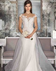 Romona Keveza Fall 2017 Wedding Dress Collection | Martha Stewart Weddings – Pearl wedding dress made of embroidered appliqué lace features an illusion neckline and a fluted skirt made of 5-ply silk crepe. Shown with a detachable illusion ball gown overskirt.