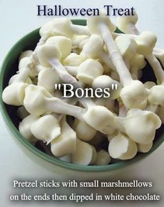 Great Snack for the Halloween table!! Very easy, and creepy too. Just pretzel sticks with marshmallows on the ends, dipped in white chocolate.