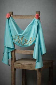 Teal and gold chair swag  | #wedding seating