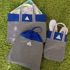 「ヒッコリー」の入園入学3点セットです。ちょっぴりお得になってます。ヒッコリーデニムとブルー帆布のバックです。ヒッコリーはとてもやわらかく、デニムのごわごわ感はありません。元気カラーのブルーと三角タグがアクセントです