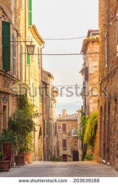 http://thumb1.shutterstock.com/display_pic_with_logo/1491170/203639188/stock-photo-twisted-medieval-streets-with-colorful-flowers-and-green-plants-in-castelmuzio-italy-203639188.jpg