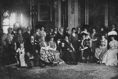 Historic Royal Picture 1907, A luncheon party at Windsor was the occasion for 24 Royals to gather together. Mr. William Downey, the court photographer, used an arc lamp of 10,000 candle-power to aid the failing light. The Boy Prince Olaf of Norway is to the extreme left of the front row, next to King Edward VII. The Kaiser stands between the Queen of Norway and the Princess of Wales (later Queen Mary). The King of Spain stands with a hand on the shoulder of the Prince of Wales (King George)