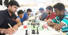 Players showing keen interest in Chess Cship matches.