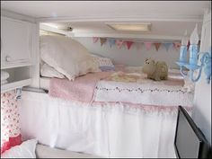 Wow!  Now that is a motorhome remodel!!  Love the pennants and the idea of making it a girly cove for my girls.  All the turquoise and white is fabulous.