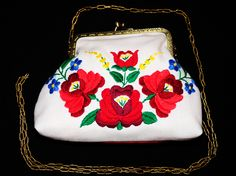 This little bag was recycled from my mother's old tablecloth and I also added some cotton canvas. It has a beautiful Hungarian needlework /called 'kalocsai'/ on the front page. The back side is red, inside yellow. This old embroidery style has become very popular and loved among Hungarians and this traditional style is spreading worldwide, too.Size: 15 cm X 19 cm