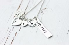 Sterling Silver Hand Stamped Family Necklace with a family tree charm , hand stamped initial hearts and a hand stamped date bar. Order one today at www.Facebook.com/CoreyTreacyDesigns.com Hand Stamped Necklace, Dog Tag Necklace, Date Bars, Family Necklace, Initials, Hearts, Charmed, Necklaces, Facebook