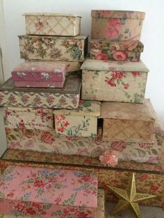 Floral fabric-covered and decoupaged boxes and chests.