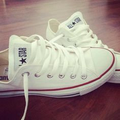I love these white Converse with a dark pair of cuffed blue jeans :)