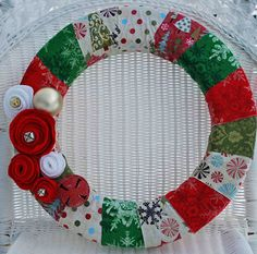 Christmas wreath--I like the ornament and big bell by the flowers.
