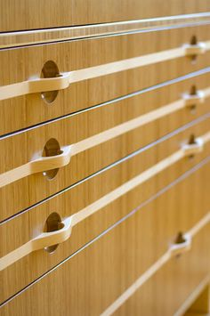 carmelized bamboo flat files with sculpted maple integrated drawer pulls