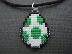 Hey, I found this really awesome Etsy listing at https://www.etsy.com/listing/164437393/yoshi-egg-necklace-seed-bead-video-game