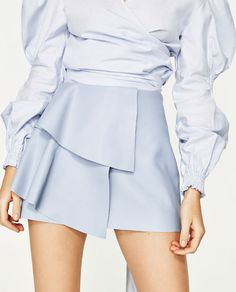 Image 4 of LEATHER-EFFECT MINI SKIRT WITH FRILLS from Zara
