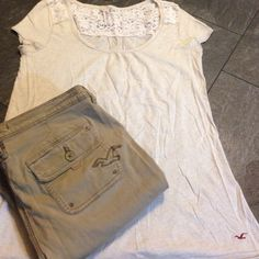 Hollister Oatmeal Crochet Tee Size L Soft oatmeal colored material with cute crochet  emblem on back color of tee. Free flowing and comfortable to wear. Hollister Tops Tees - Short Sleeve