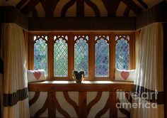 """""""Window Of Hearts"""" photograph by Linda Prewer.  This glorious bay window inviting you in, to gaze through leaded glass, holding these carefully placed hearts which fill the space with love. Contemporary Fine Art Prints, Posters, Canvas Prints available in various sizes and frames with or without mount (matte). Greetings Cards £3.45 Prints from £16.00 linda-prewer.artistwebsites.com #heart #window #valentine #interior #style #home"""