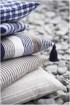 Swedish Fabric Company -  Linum Fabric Collection - Grey, cream and blue striped cushions, with a tassel on one corner