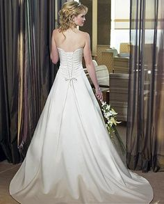 I would really love a dress that laces like this one. Similar to the Taylor Swift Love Story one.
