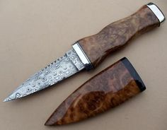Rc-113 Sgian Dubh by David Brodziak.  With scabbard this is one good looking knife.    Blade:Damasteel