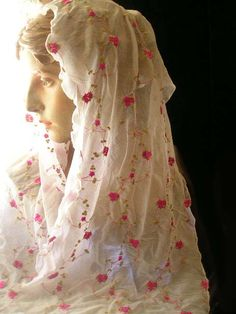 "18.00 Pink and Gold Embroidered Chiffon Rectangle Veil. The chapel veil is not a ""doily"" or a ""burqa."" It is not for submission before men, but humility, modesty, and submission before The Lord in the Blessed Sacrament. It does not keep a woman ""down"" or ""in her place,"" but modesty and humility enable her to be receptive to God and His strength. There is no better teacher and enabler in being a strong woman than The Lord."