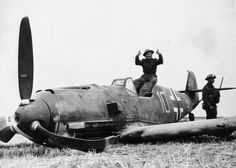 A soldier poses with Me 109E-4 Yellow 10 of JG51 flown by Ofw Fritz Beeck. Escorting Ju 88 bombers attacking RAF Manston on 24 August 1940, the fighter pilot managed to force land his aircraft alongside the Dover-Deal road at East Langdon, following combat with No 32 Squadron RAF. The pilot was captured unhurt.