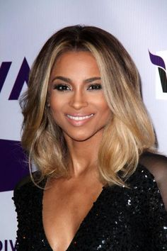 Lovely honey highlights in the front pieces of a shoulder-length haircut will add dimension to dark-hued hair. #haircolor #haircut