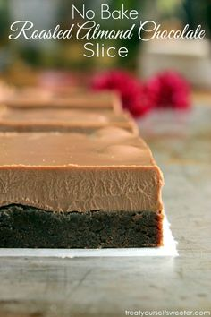 No Bake Double Chocolate Roasted Almond Slice; a sweet, chocolatey biscuit base with a smooth milk chocolate top mixed with roasted almonds. A super easy, decadent chocolate slice.