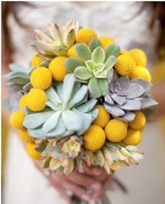 Fun & funky wedding flower choice. Not sure if it works for me. But love the flower balls