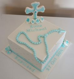 Catholic Baptism cake with hand made rosary beads, cross and roses.  See my Facebook Page Driving Me Cakey for  more photos of my work.  Located in Fairview Park South Australia.