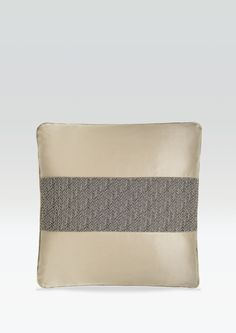 JEAN ARMANI  The cushion cover Jean has a horizontal band made of a three dimensional fabric with intertwined design. This cushion cover is presented in a single colour variant. Made in Italy.  Dimensions:    CM 40x40 - INCH 15,7x15,7
