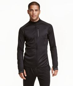 Check this out! Running jacket in fast-drying, breathable functional fabric with ventilating mesh sections at back, under arms and at sides. Stand-up collar, zip at front, side pockets, chest pocket with zip, and reflective details. Unlined. Regular fit. Size of chest pocket 4 x 5 3/4 in. - Visit hm.com to see more.
