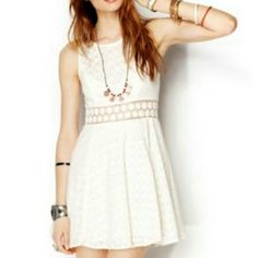 HP 🎉 Free People Fitted with Daisies Texturized fit-n-flare tank mini dress with daisy chain cutout detailing around waist. Zips up the back. I have in red and black also :). Free People Dresses Mini