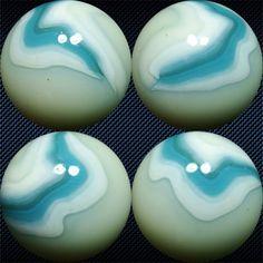"Rare Vitro Agate ""Wedding Cake"" marble with a fluorescent base, 31/32"" diam."