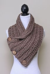 This oversized chunky cowl is designed with a loose stitch pattern that allows it to drape beautifully. No buttonholes are required as the buttons button-up between the stitches. Different looks can be created simply by changing how the scarf is buttoned up.