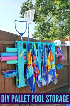 Super cool summer project! Hang towels and organize all your pool toys and accessories!!!  Pool Pallet Project, Pallet Project, DIY Pool Ideas, DIY Pool Storage Ideas, DIY Pool Storage Pallets, DIY Pool Organization, DIY Pool Organizer Storage,  DIY Pool Organization Ideas, Pool Noodles, pool organization ideas, pool towel rack, pool organization ideas diy project #jugglingactmama #diyproject #palletproject
