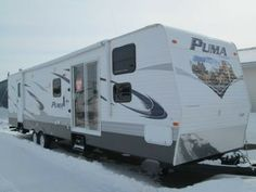 2014 Puma, 32 DBKS $36,900 A MUST SEE  -  This is a nice family camper (sleeps 6-8 people) with 3 slides, cherry cabinets, island in the kitchen, TV in the bunk house, outside kitchen, power jacks, electric awning and much, much more!