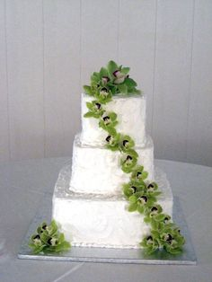 Green Cymbidium Orchid Cake Flowers   Design By Beth Parker www.earlesflowers.com  Earle's Loveland Floral and Gifts   1421 N. Denver Ave Loveland, CO 80538  970.667.7550