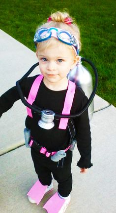 A couple of plastic soda bottles, a hot pink belt, and water goggles. Grab 'em and you've got yourself an underwater adventurer ready for deep-sea diving. Side note: This little girl's parents dressed as sharks. How cool is that?! Get the D.I.Y. from Artsy Fartsy Mama.   - Redbook.com