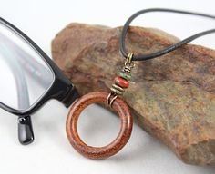 Rustic natural wood eyeglass holder with accent gem (black tourmaline, turquoise, jasper/jade) is available on black leather cord or antique bronze chain. Gender neutral, earthy… and a great way to hang on to those glasses! Leather eyeglass lanyard, Mens Eyeglass Chain.