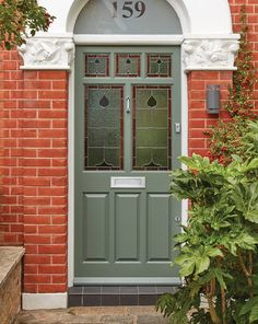 This traditional green Victorian door provides a striking contrast to the red bricks it sits against. The intricate design and detail showcases what can be achieved by London Door Company craftsmen. House Front Door, Glass Front Door, Sliding Glass Door, Glass Doors, Etched Glass Door, Stained Glass Door, Green Front Doors, Front Door Colors, Victorian Fonts