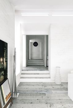 grey flooring - this may be too distressed - but the advantage is that the clean, minimalist look is maintained.