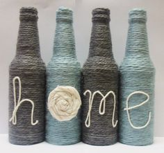 Yarn Wrapped Twine Bottles Home Decor Grey and Blue Decor Twine Bottles, Twine Wrapped Bottles, Glass Bottles, Wine Bottle Art, Wine Bottle Crafts, Bottle Lamps, Twine Crafts, Yarn Crafts, Fabric Rosette
