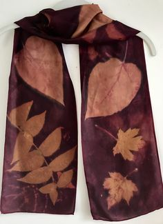 Silk scarf dyed with Brazilwood shavings (from a violin bow maker) and eco printed with Sumac and Catalpa leaves - by Diane Gamm