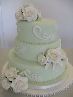 Beautiful, soft green cake with crisp white swirls that lead your eye up to the pretty, white sugar flowers.