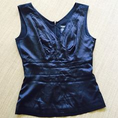 Silk Black Tank Top Dressy silk black tank top. V- cut neckline and zipper up the back. Worn once- excellent condition. Express Tops Tank Tops
