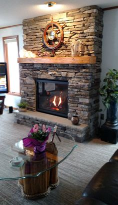 """We just completed this unique fireplace upgrade that beautifully compliments this home on the river. Kozy Heat """"Bayport 41"""" gas fireplace with black enamel interior. Cultured Stone """"Southern Ledgestone"""" in bucks county color. Custom built mantel in hand hewn knotty alder."""