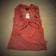 NWT: BR silky top Never worn gorgeous Banana Republic blouse with ruffle neckline and a bow at the front. Fabric covered buttons and an adorable pattern in coral and olive. The perfect spring blouse! Pair with a blazer or pencil skirt for the office or with jeans and sandals for a laid-back Saturday afternoon! Tag says XS but would also fit a small Banana Republic Tops Blouses