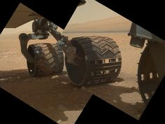 This view of the three left wheels of NASA's Mars rover Curiosity combines two images that were taken by the rover's Mars Hand Lens Imager (MAHLI) during the 34th Martian day, or sol, of Curiosity's work on Mars (Sept. 9, 2012). In the distance is the lower slope of Mount Sharp. Credit: NASA/JPL-Caltech/Malin Space Science Systems