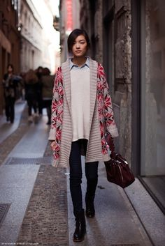 Play in ponchos by layering sweaters and blouses underneath